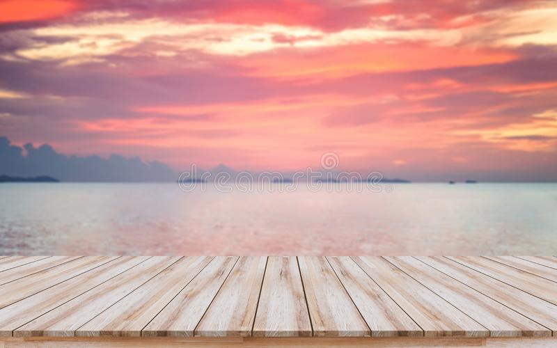 Empty wooden board with beautiful sunset for products display or visual design key layout stock photography