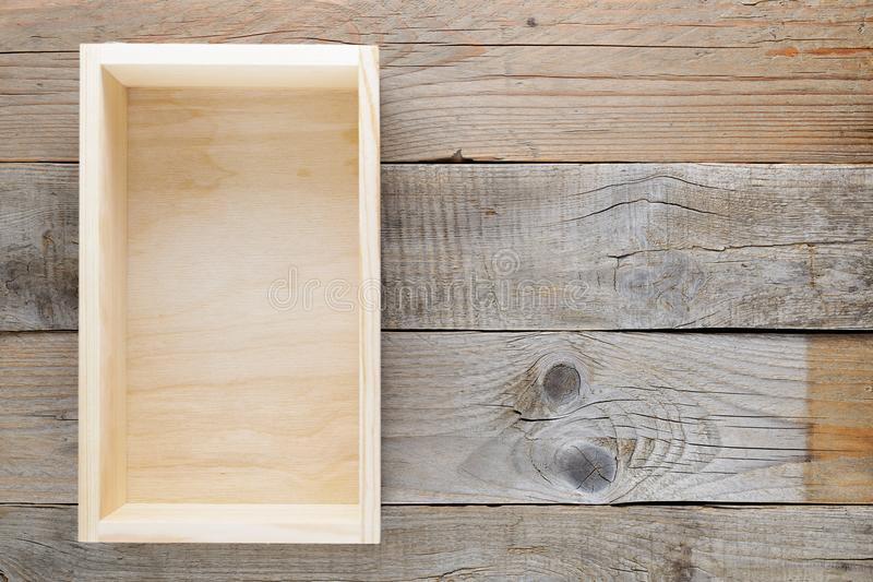 Empty wooden box on old wooden table stock photos