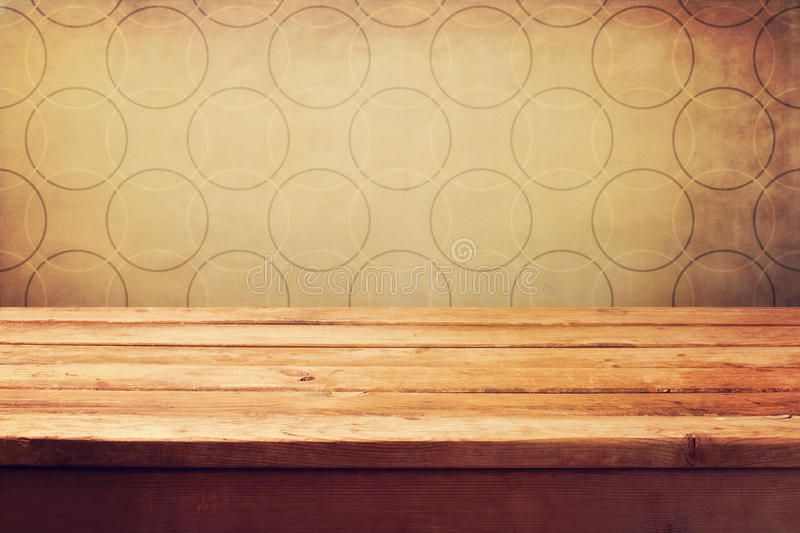 Empty wooden deck table. Over grunge retro wallpaper stock photography