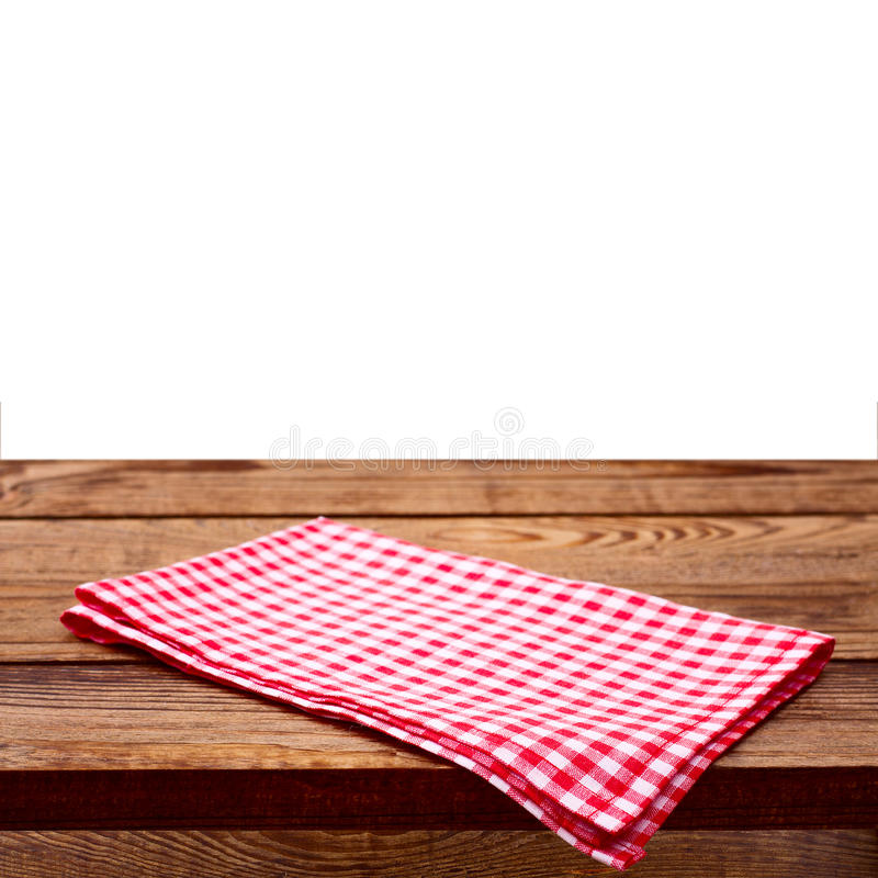 Empty wooden deck table with tablecloth stock photography