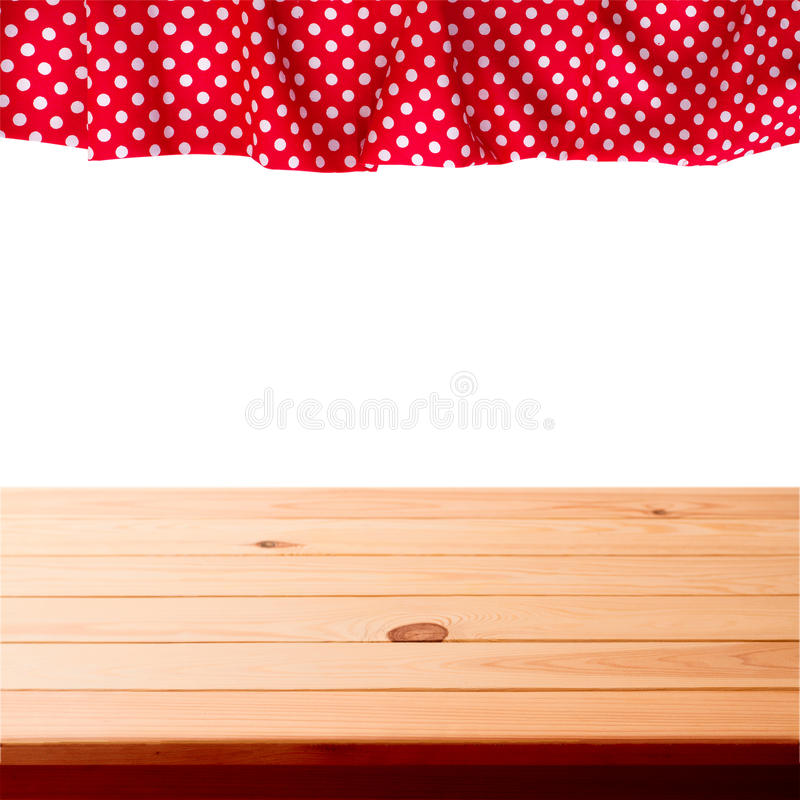 Empty wooden deck table with tablecloth for product montage. stock photos