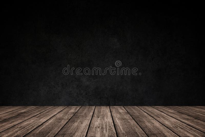 Empty wooden floor with dark concrete wall background, For product display. For put product on shelves royalty free stock images