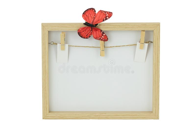 Empty wooden frame with a clothesline and clothespins on the background of frame. Isolated on white background. royalty free stock photo