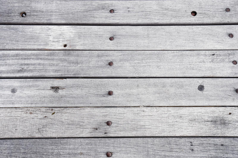 Empty wooden painted white table surface, light colored wood texture background, vintage planks with old natural pattern stock photos