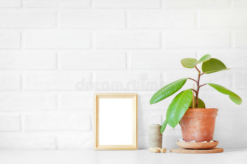 Empty wooden picture frame with white space is on the table with royalty free stock photography