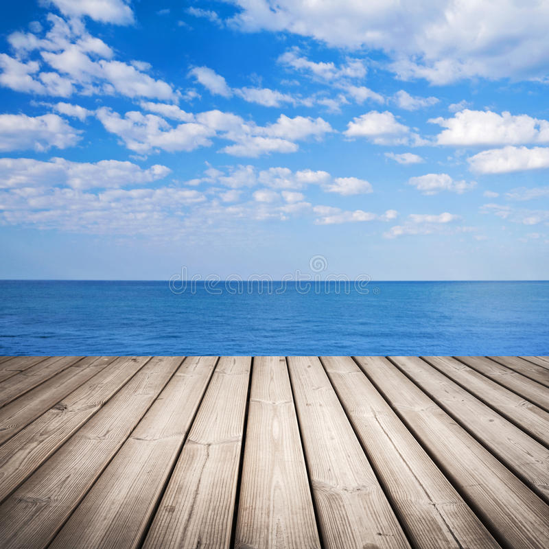 Wood Table Top On Blurred Beach Background Vintage Tone: Empty Wooden Pier Over Blurred Tropical Beach Stock Image