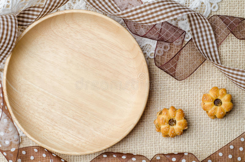 Download Empty Wooden Plate With Coconut Biscuit And Pineapple Jam Stock Photo - Image: 83700244