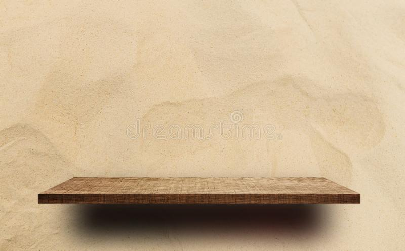 Empty wooden shelf counter on sand background royalty free stock image
