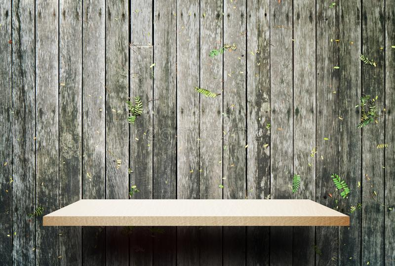 Empty wooden shelf display with fence background royalty free stock images