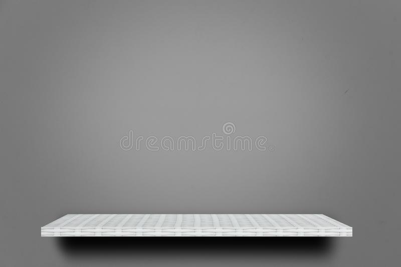 Wooden shelf on gray cement wall for product display stock images