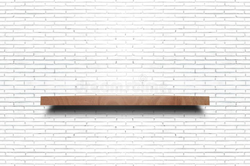 Empty wooden shelf on old white brick wall. Texture. For display products stock photography