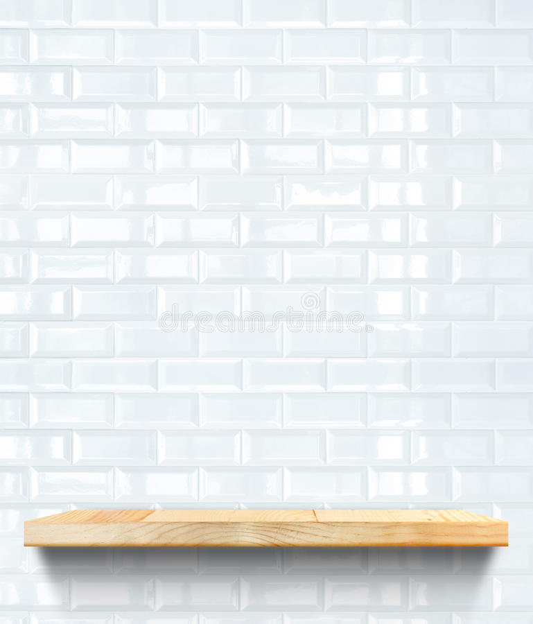Empty Wooden shelf at white tile ceramic wall,Template mock up f. Or display of product,business presentation stock image