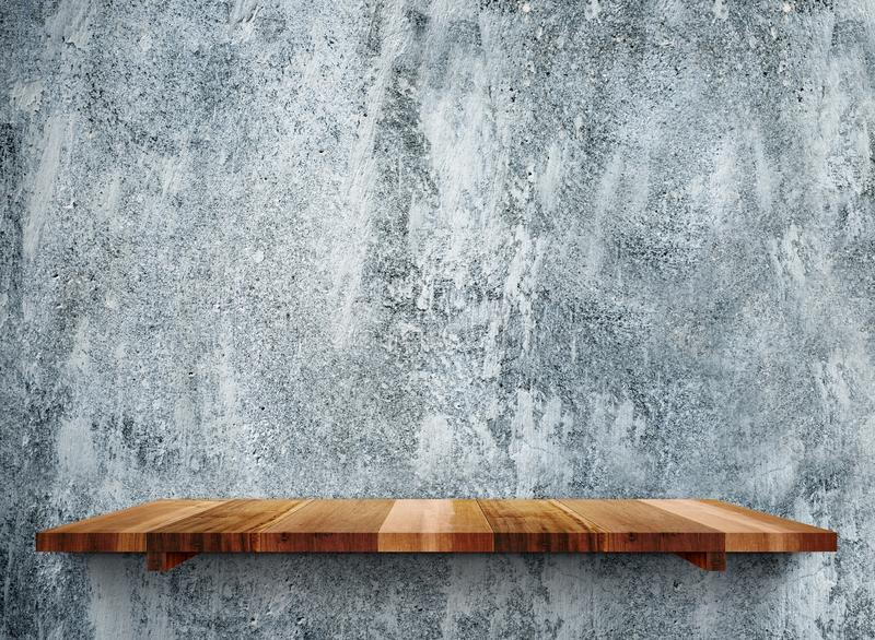 Empty wooden shelfs on grunge grey stone wall, Mock up template royalty free stock photography