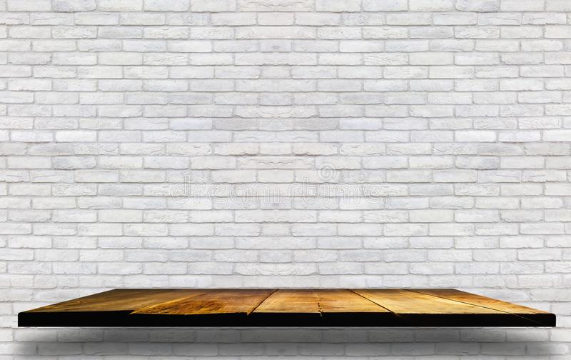 empty wooden shelves on brick concrete wall ,Background for prod stock photography