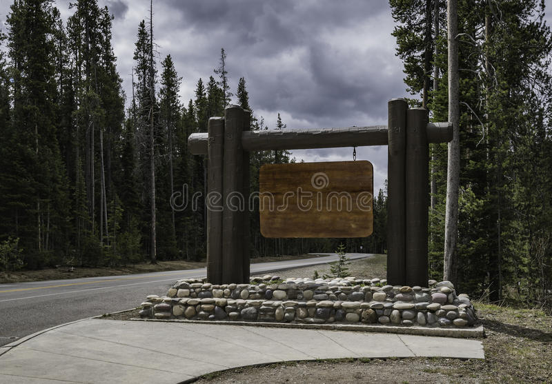 Empty wooden sign along the road royalty free stock photo
