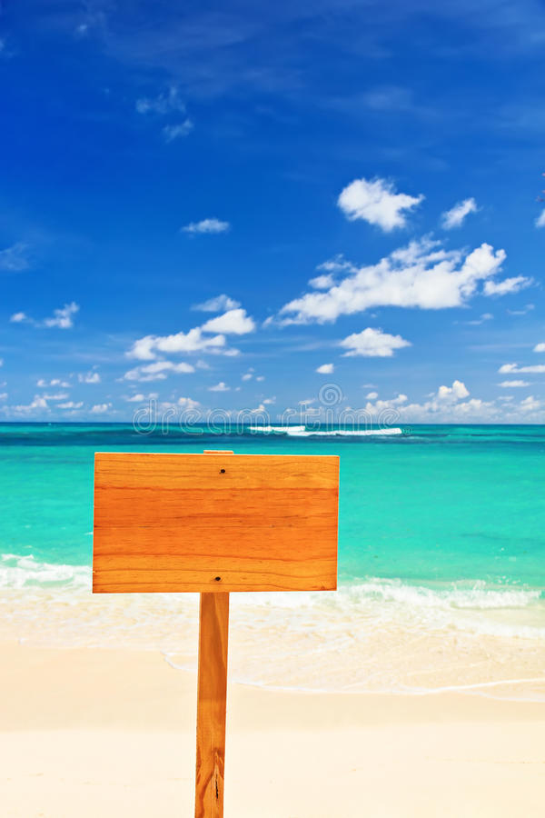 Empty wooden sign on beach. Empty wood sign on beach royalty free stock photography