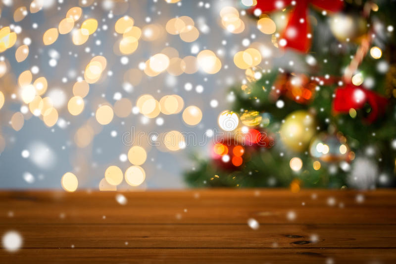 Empty wooden surface over christmas tree lights stock image