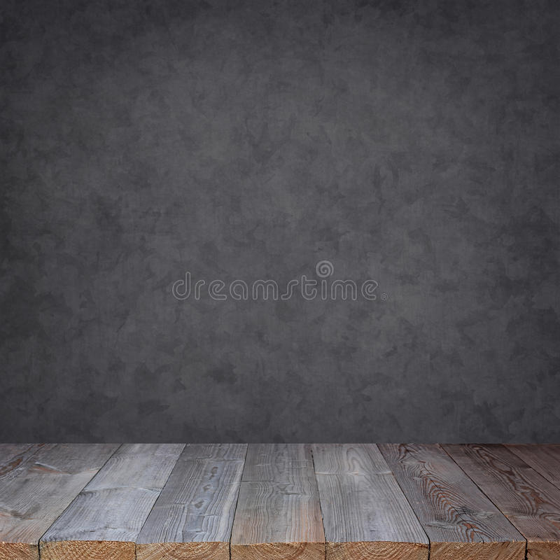 Empty wooden table against a grey wall. stock image