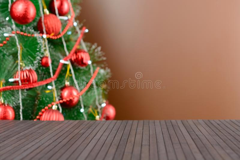 Empty wooden table in the background of decorated Christmas tree royalty free stock photo