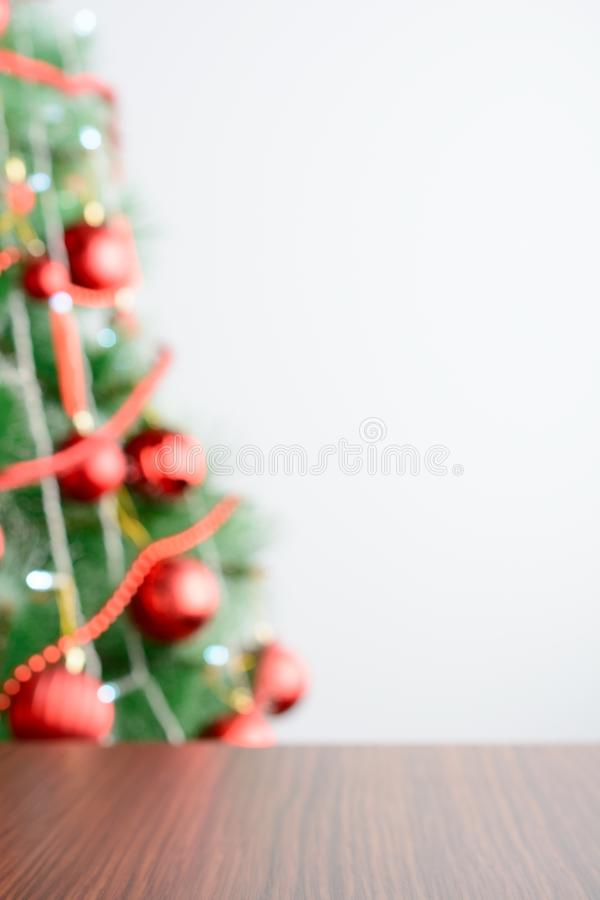 Empty wooden table in the background of decorated Christmas tree royalty free stock images