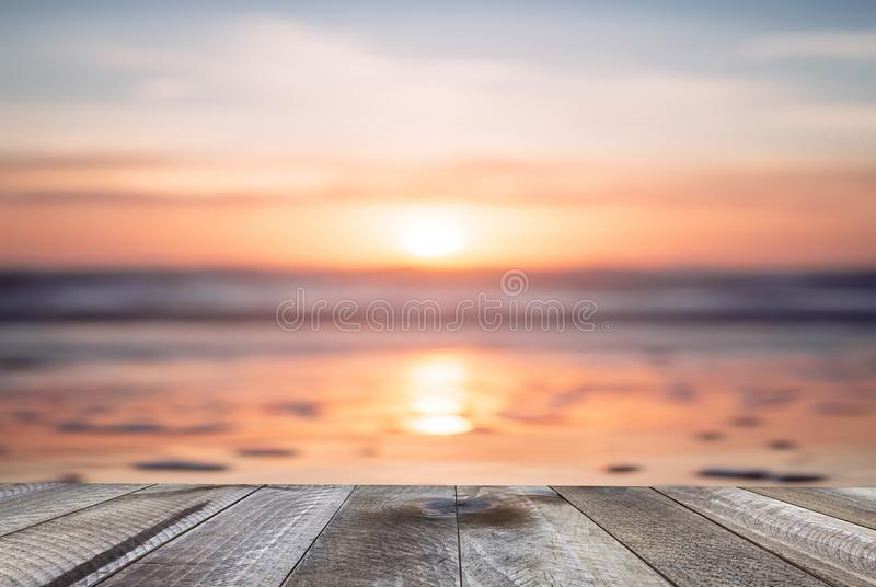 Empty wooden table and beautiful ocean with sunset. Background royalty free stock image