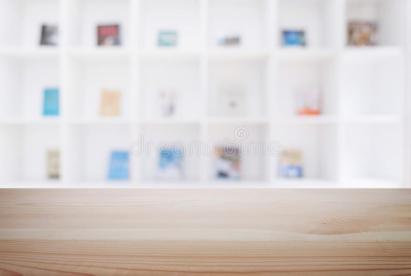 Empty wooden table and blur background of abstract in front of m. Odern library or knowledge source can be used Mock up for display of product or for montage stock photo