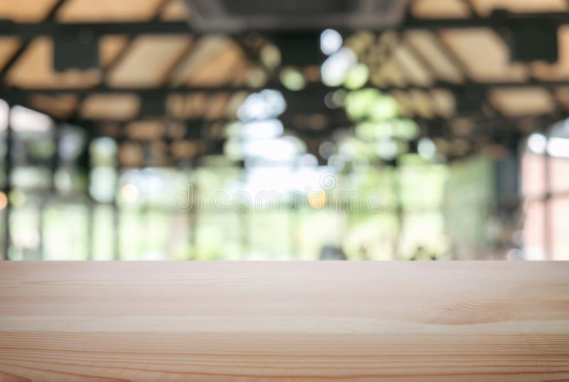 Empty wooden table and blur background of abstract in front of r stock image
