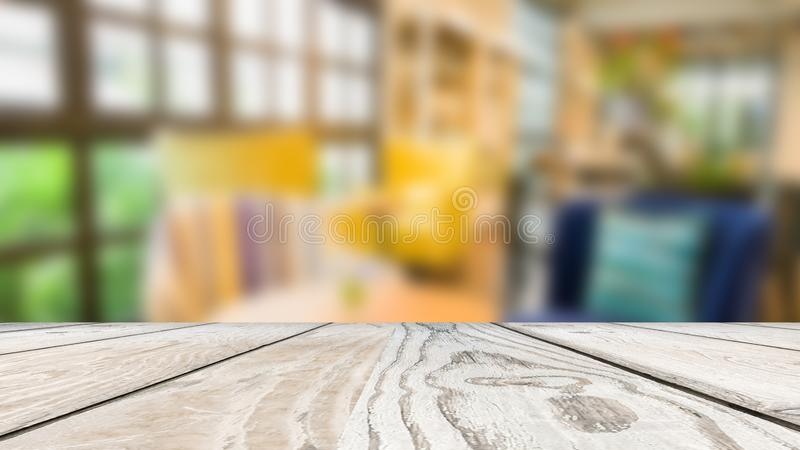 Empty. wooden table on blur of coffee shop, with yellow and blue luxury sofa, background, Used for display or montage your. Production royalty free stock images