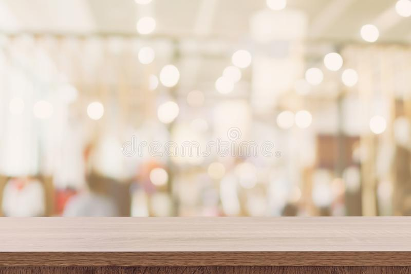 Empty wooden table with blurred abstract people on cafe on restaurant background.  stock image