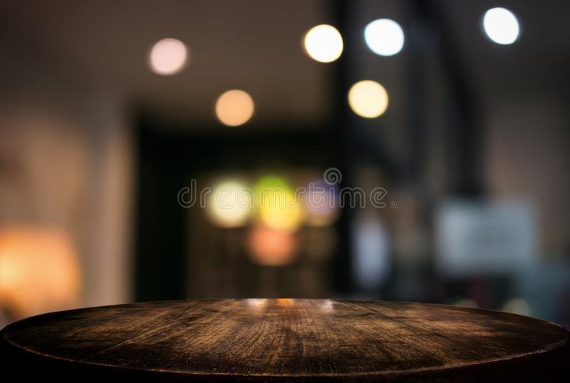 Empty wooden table and blurred background of abstract in front o. F restaurant or coffee shop for display of product or for montage stock photo