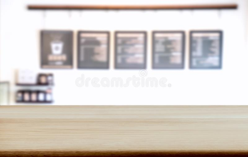 Empty wooden table and blurred background of abstract in front o. F coffee shop or restaurant for display of product or for montage stock images