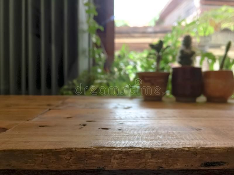 Empty wooden table with blurred cafe background. Empty wooden table with blurred cafe background royalty free stock photo