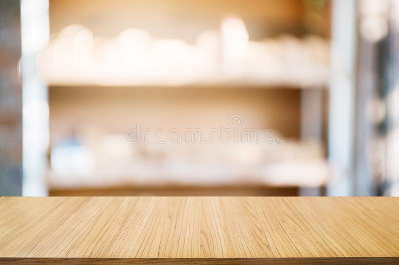 Empty wooden table with blurred tools shelf background royalty free stock images
