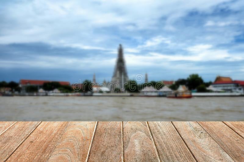 Empty Wooden Table with Blurred Wat Arun Temple. stock images