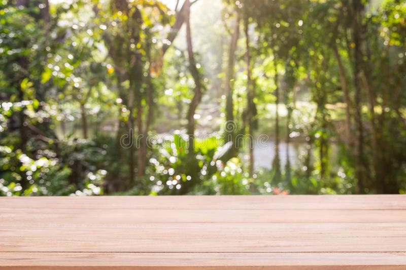 Empty wooden table with Defocus nature green bokeh, abstract nature background stock images
