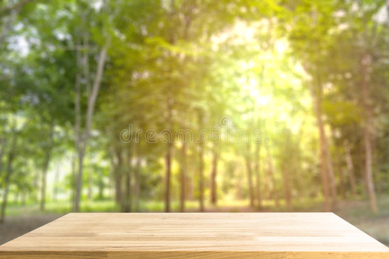 Empty Wooden table for display product and blurry forest in back. Ground. Abstract background stock photo