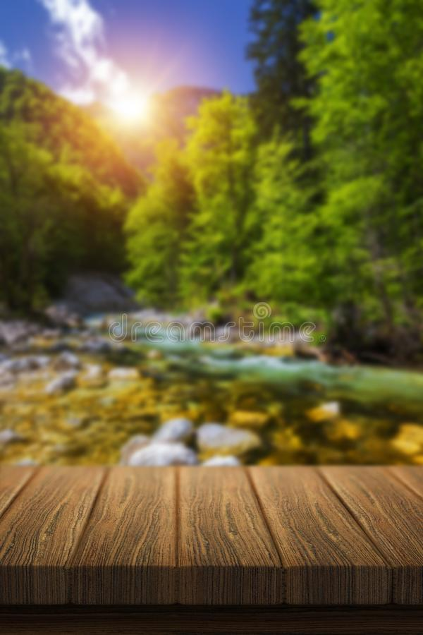 Empty wooden table in front of abstract blurred background in nature, can be used for display or montage your products. Mock up stock photos