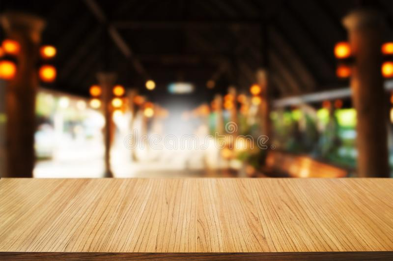 Empty wooden table in front of blur montage abstract background.  stock image