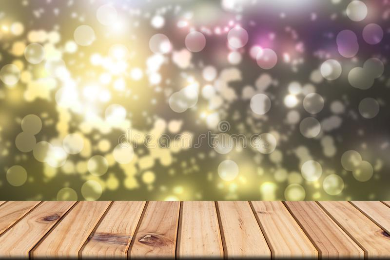 Empty wooden table on front blurred colorful bokeh background stock photos