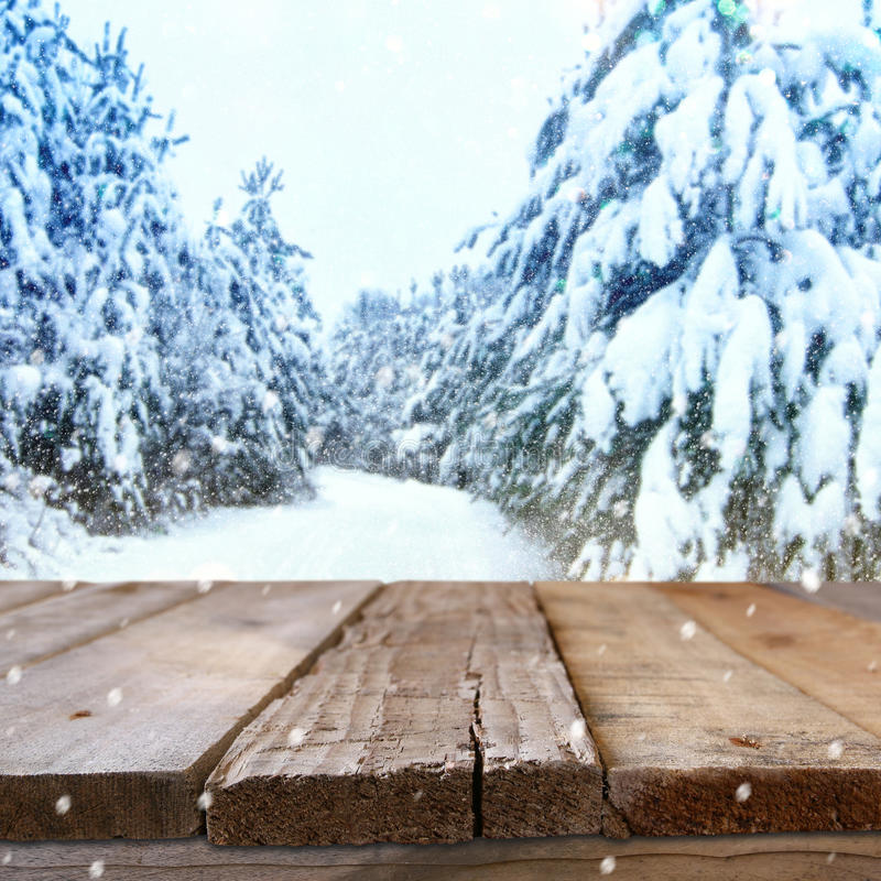Empty wooden table in front of dreamy winter landscape royalty free stock photos