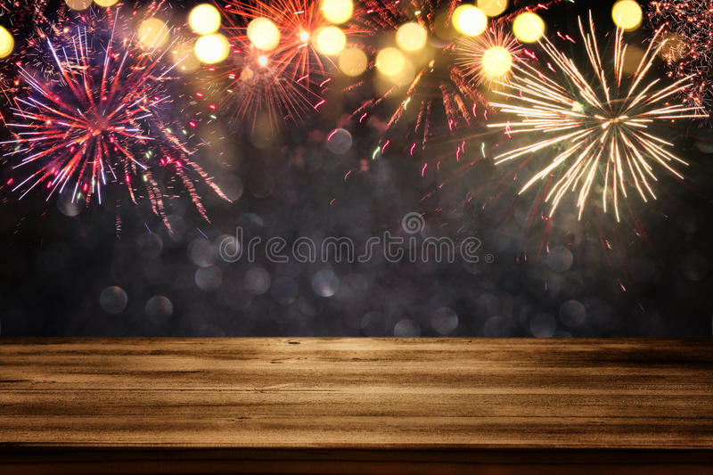 Empty wooden table in front of fireworks background stock photography