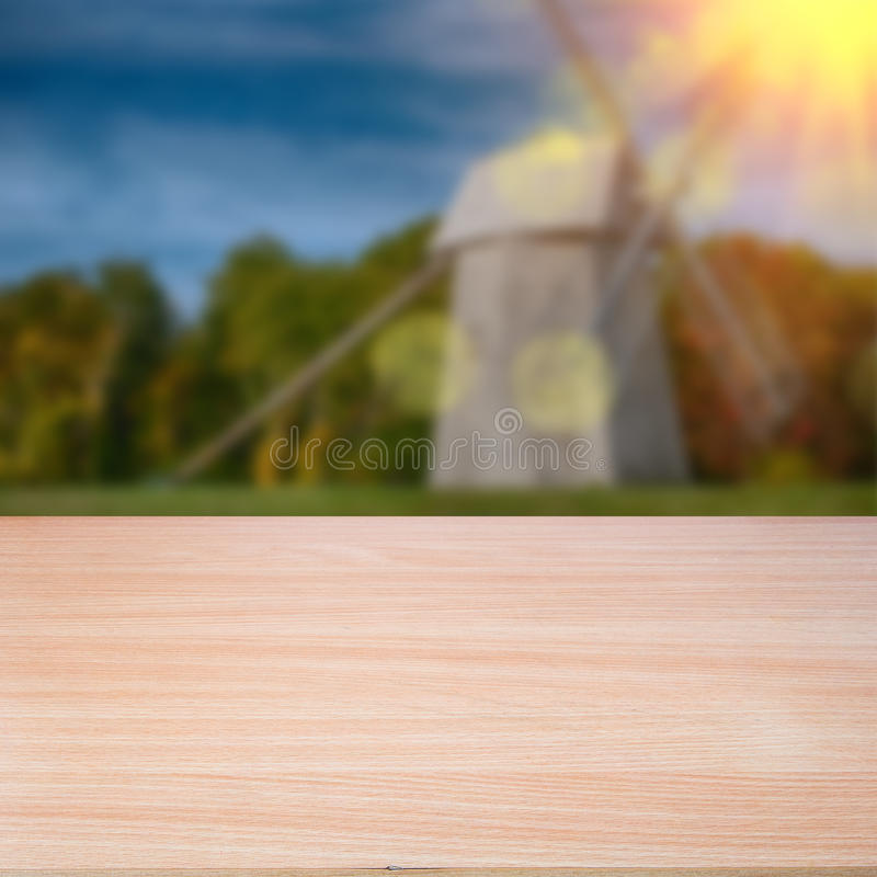 Wood Table Top On Blurred Beach Background Vintage Tone: Empty Wooden Deck Table Over Sunset Bokeh Background Stock