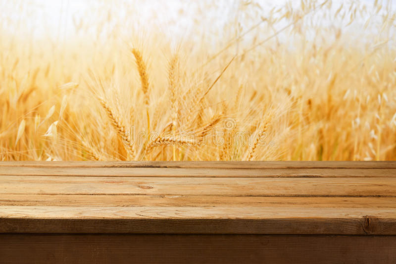 Empty wooden table over wheat field background. Empty wooden table over wheat field stock photos