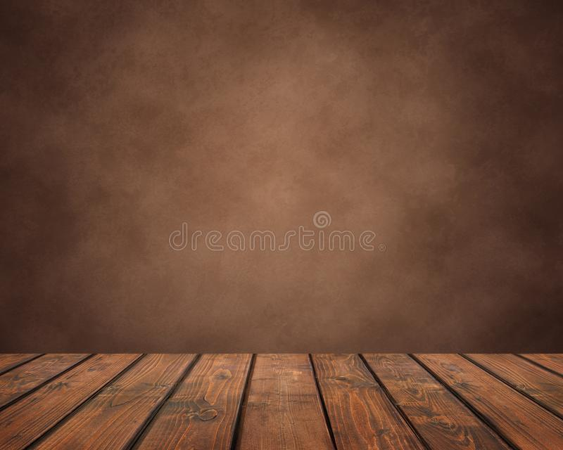 Empty wooden table of planks on a brown grunge background. countertop, work surface. On the back of the wall. Empty space for Your subject royalty free stock photo