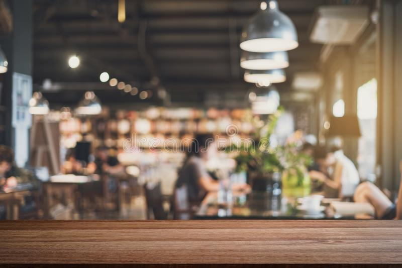Empty wooden table space platform and blurry defocused restaurant stock image