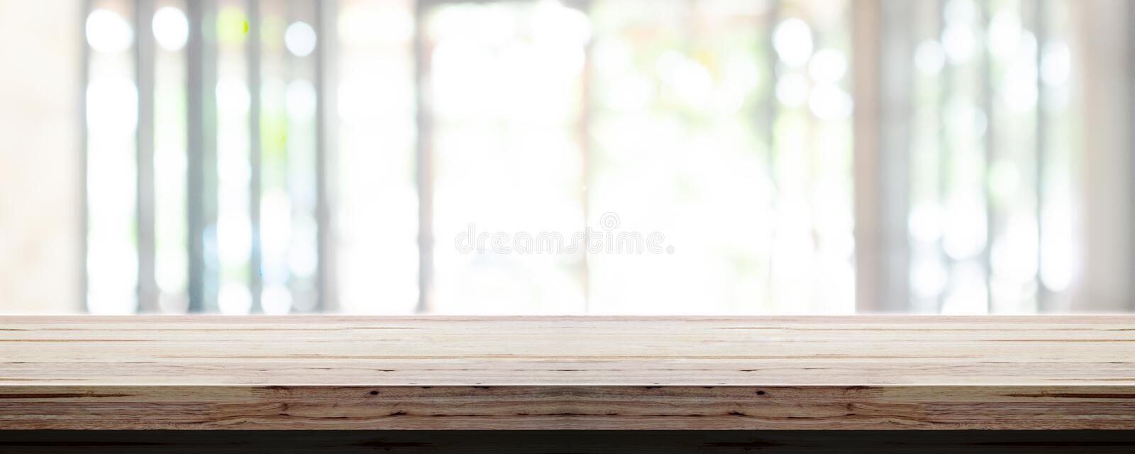 Empty wooden table top with blur office interior background, Panoramic banner. Abstract background royalty free stock image