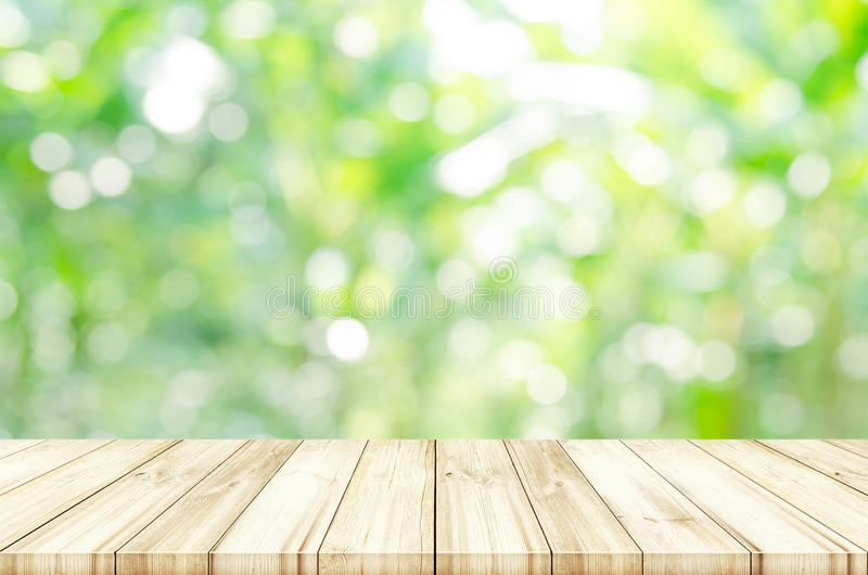 Empty wooden table top with blurred natural abstract background. royalty free stock image
