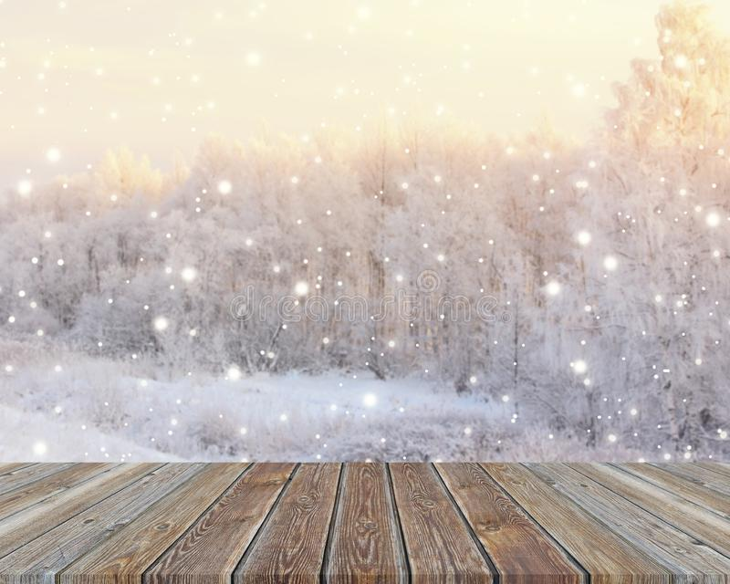 Empty wooden table top on blurred winter backdrop with snowflake royalty free stock image