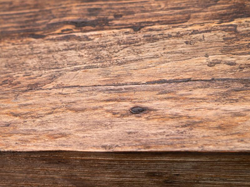 Empty wooden table top, close up of texture backgrounds. Old brown pine planks royalty free stock image