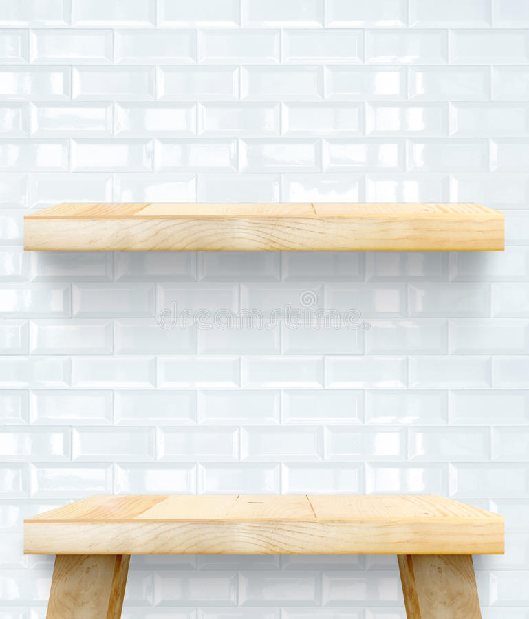 Empty Wooden Table top and shelf at white tile ceramic wall,Temp. Late mock up for display of your product stock photo